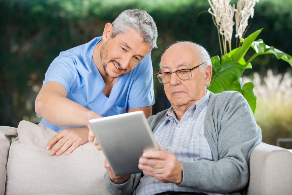 health care provider assisting senior in not choosing the wrong hospice care