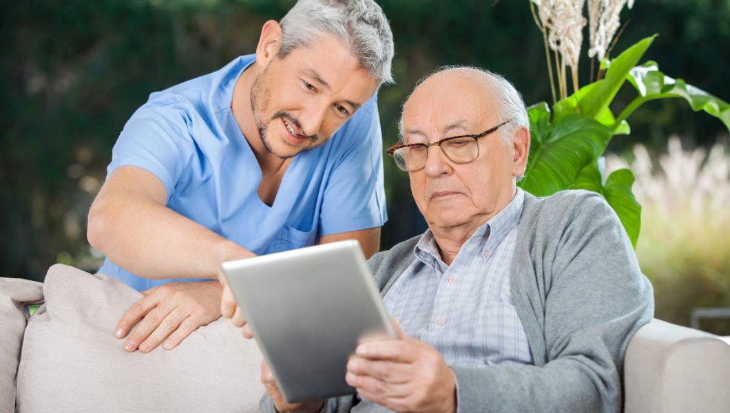 health care provider assisting senior in choosing the right hospice care